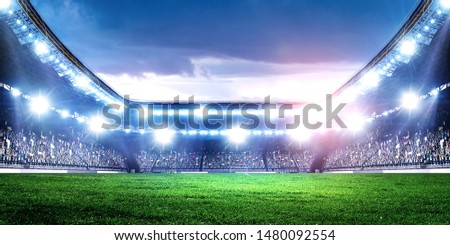 Full night football arena in lights Royalty-Free Stock Photo #1480092554