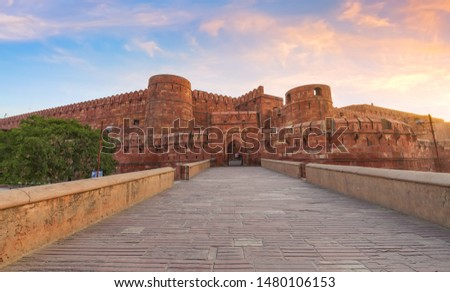 Agra Fort red sandstone medieval fort in panoramic view at sunrise. Agra Fort is a UNESCO World Heritage site in the city of Agra India. Royalty-Free Stock Photo #1480106153