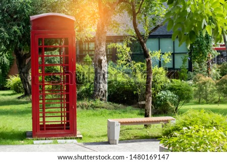 Red telephone box used for decorating the garden. #1480169147