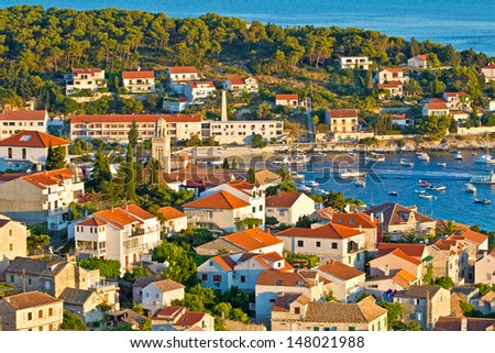 European Southern City Scape. Sea, Bay, Boat, Mountain, Houses, Blue Sky, Resort & Holiday. Hvar. Croatia. High quality stock photo.