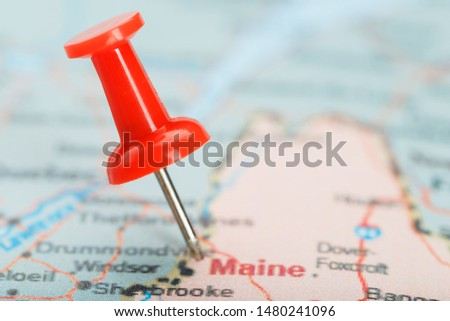 Red clerical needle on a map of USA, South South Maine and the capital Augusta. Close up map of South South Maine with red tack #1480241096