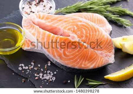 Raw, fresh salmon steak on a slate board and spices around. Raw salmon red fish. Cooking salmon, seafood. Healthy food concept. Salmon and spices #1480398278