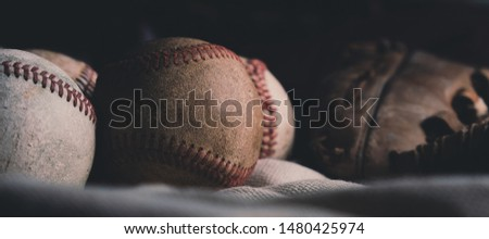 Baseballs close up in detail show old used leather sports equipment for baseball banner. #1480425974