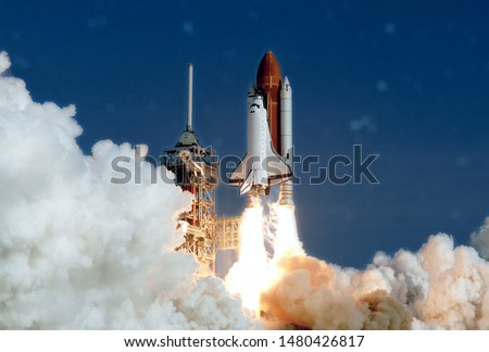 The launch of the space shuttle. With fire and smoke. Against the background of the starry sky. Elements of this image were furnished by NASA #1480426817