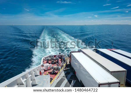 Trucks on a ferry at sea, freight transportation between Dover and Calais Royalty-Free Stock Photo #1480464722