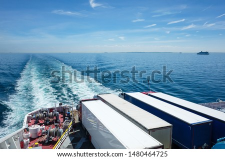 Trucks on a ferry at sea, freight transportation between Dover and Calais #1480464725