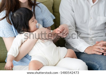 Parents discussing parenting on the sofa #1480542473