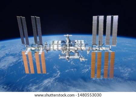 International Space Station over the planet. Elements of this image were furnished by NASA #1480553030