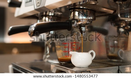two black coffee morning on coffee maker #1480553477