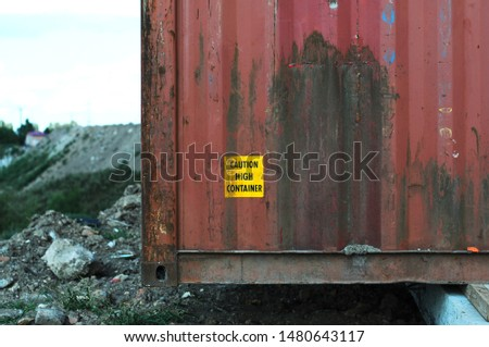 Sign caution high container on a red Container