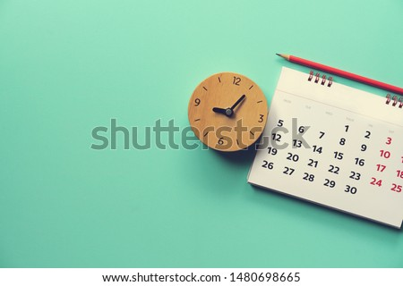 close up of calendar and alarm clock on the green table, planning for business meeting or travel planning concept #1480698665