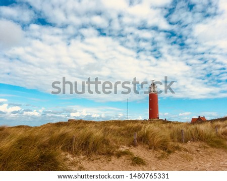 Lighthouse on the island Texel off the coast of The Netherlands #1480765331