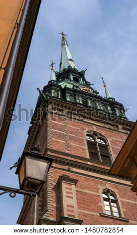 Sweden, Stockholm, on an old street in Gamlastan. The ancient part of the city. The bell tower of the German church #1480782854