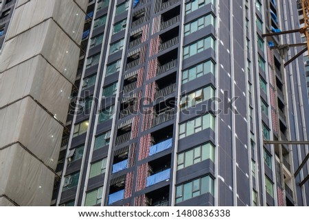 Construction site modern high rise condominium building in growth business city #1480836338