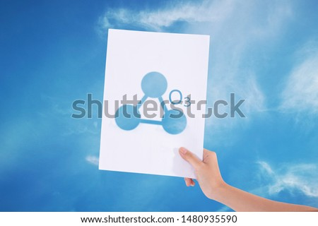 Female hands holding white paper with sign ozone o3 in blue sky background./Ozone concept  Royalty-Free Stock Photo #1480935590