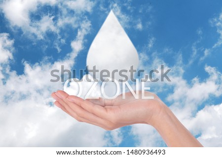 Clouds shaped like drops ozone of water in woman hands on blue sky background  Royalty-Free Stock Photo #1480936493