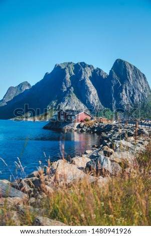 View of the city of Rhine on the Lofoten islands, a beautiful bright landscape, white and red houses on the background of rocks #1480941926