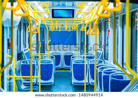 City bus. Land transport in the city. Passengers seats. Bus equipped with handrails for holding. Information screen in transport. Non-cash payment bus validators. Public urban passenger transport. #1480944914
