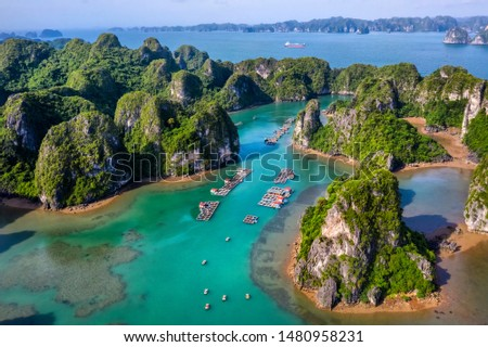 Aerial view Vung Vieng floating fishing village and rock island, Halong Bay, Vietnam, Southeast Asia. UNESCO World Heritage Site. Junk boat cruise to Ha Long Bay. Famous destination of Vietnam Royalty-Free Stock Photo #1480958231