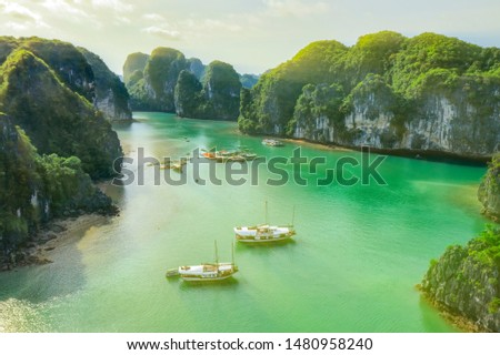 Aerial view Vung Vieng floating fishing village and rock island, Halong Bay, Vietnam, Southeast Asia. UNESCO World Heritage Site. Junk boat cruise to Ha Long Bay. Famous destination of Vietnam Royalty-Free Stock Photo #1480958240