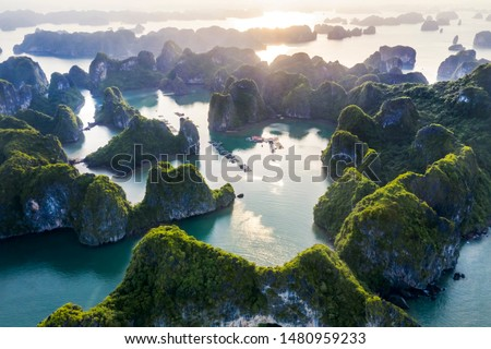Aerial view Vung Vieng floating fishing village and rock island, Halong Bay, Vietnam, Southeast Asia. UNESCO World Heritage Site. Junk boat cruise to Ha Long Bay. Famous destination of Vietnam Royalty-Free Stock Photo #1480959233