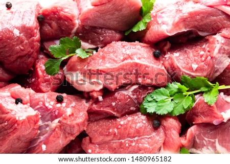 Sliced  raw beef with tarragon herb isolated on white  #1480965182