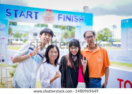 Chiang Rai, THAILAND: 8: 10: 2019: THE Woman In Gown Celebrating on Campus, Thammasat University are take photo as a souvenir in Chiang Rai THAILAND. #1480969649
