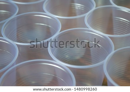 transparent disposable plastic cups on wooden table #1480998260