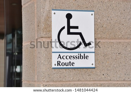 Accessible route for handicapped sign posted on the wall