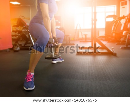 girl in the gym doing exercises #1481076575