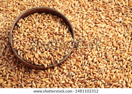 Natural,ripe wheat grains in the bamboo bowl on grains background #1481102312