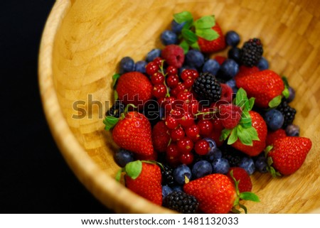 fresh berries fruit in wooden bowl includes strawberry, raspberry,blue berry,black berry etc. #1481132033