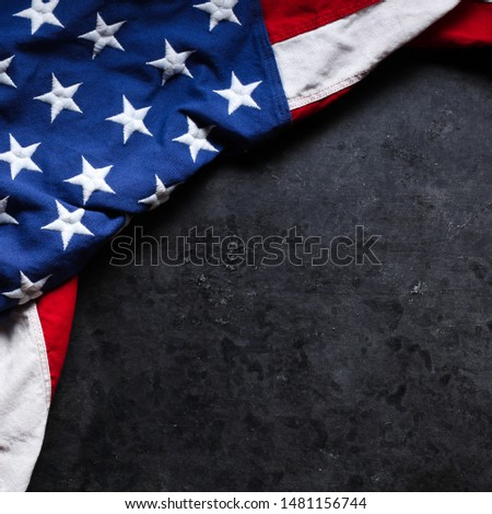 US American flag on worn black background. For USA Memorial day, Veteran's day, Labor day, or 4th of July celebration. With blank space for text. #1481156744