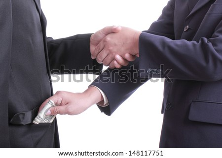 Businessman give money for corruption something with white background #148117751