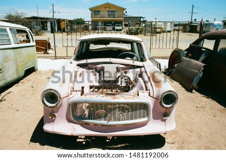 Bombay Beach, California - Feb 24 2019: A rusted pink car from the 1950s. #1481192006