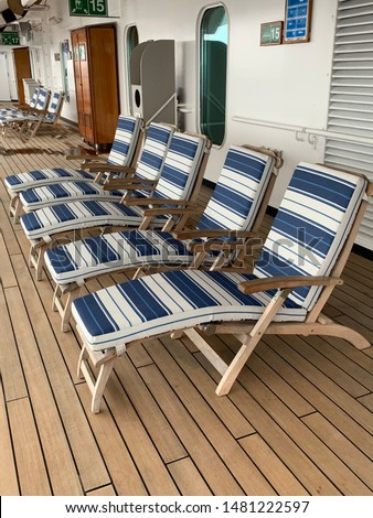 Deck chairs on deck of ship #1481222597