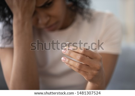 Upset african American girl hold wedding ring cry depressed with divorce, marriage dissolution, unhappy sad black young woman feel desperate breaking up. Family split, relationships problem concept #1481307524