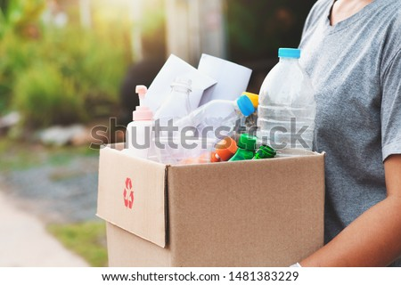 woman hand holdging box garbage for recycle Royalty-Free Stock Photo #1481383229