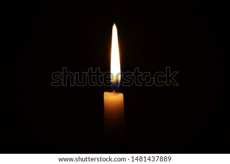 Burning candle in the dark with a dark background. Dark key photo. #1481437889