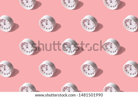 Sunlight summer pattern made with white clock on bright pink background. Minimal time concept.