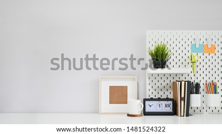 Creative table concept, Office supply with coffee mug and photo frame on white copy space desk. #1481524322