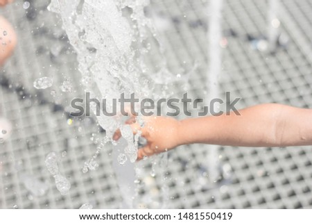 Children play in the fountain in the summer in the city #1481550419