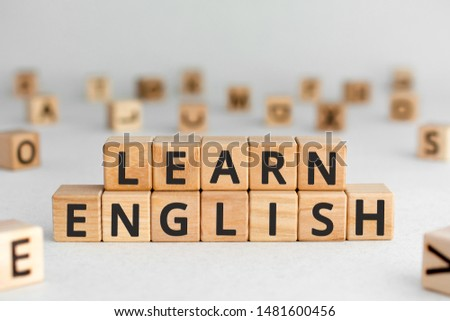 Learn English - words from wooden blocks with letters, learn how to speak English concept, random letters around, white  background #1481600456