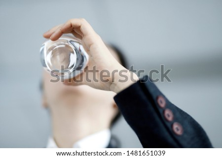 Businesswoman drinking glass of water #1481651039
