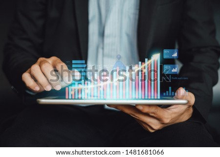 Businessman investor analyzing company financial mutual fund report working with digital augmented reality graphics technology. Concept for business, economy and marketing. #1481681066