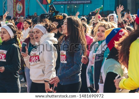 March 8, 2019 Minsk Belarus Women's Day Race on March 8 Beautiful girls athletes do warm-up in the morning before the race #1481690972