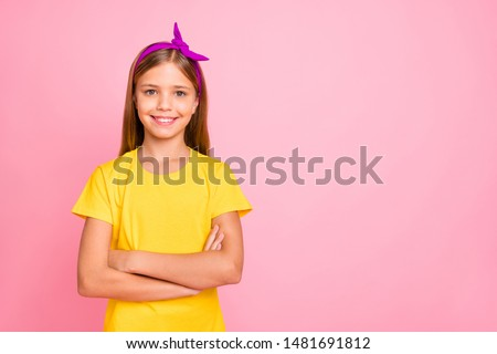 Portrait of her she nice-looking attractive pretty winsome shine cheerful cheery pre-teen girl wearing yellow tshirt folded arms isolated over pink pastel background #1481691812