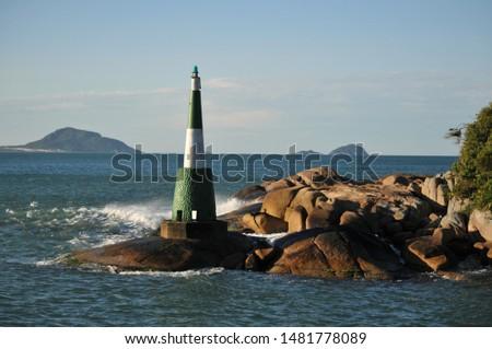 The Lagoa da Barra Lighthouse, linking Lagoa da Conceição to the Atlantic Ocean, in Florianópolis, Santa Catarina, Brazil. #1481778089