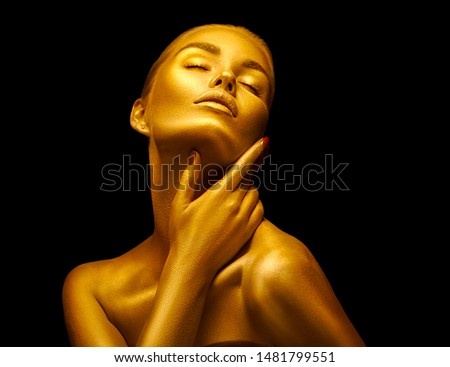 Fashion art Golden skin Woman face portrait closeup. Model girl with holiday golden Glamour shiny professional makeup. Gold jewellery, jewelry, accessories. Beauty gold metallic body, Lips and Skin #1481799551