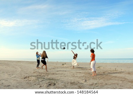 Girls playing volleyball in beach #148184564